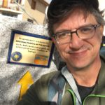 Photo of member Jeff Stys with way marker